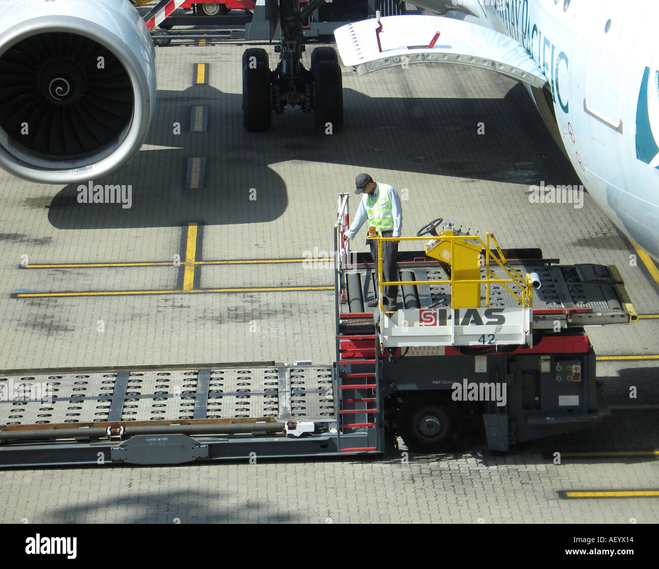 Airport baggage loader - Stock Image
