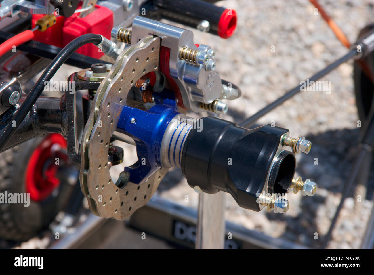 Go Kart Front Axle Assembly : Close up of a front disc brake and hub assembly go