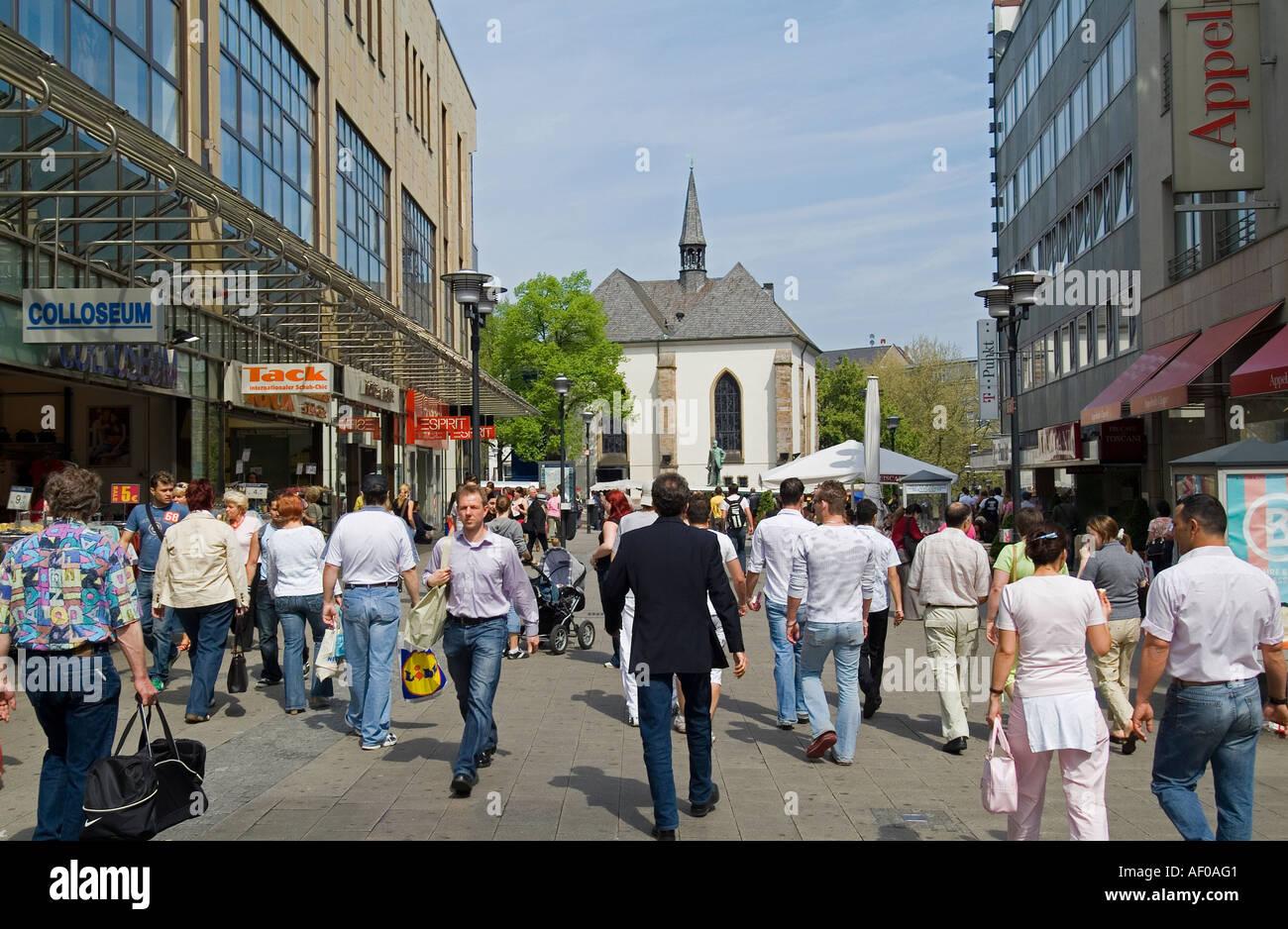 pedestrian area in Essen street Kettwiger Straße Marktkirche Market Church in background - Stock Image
