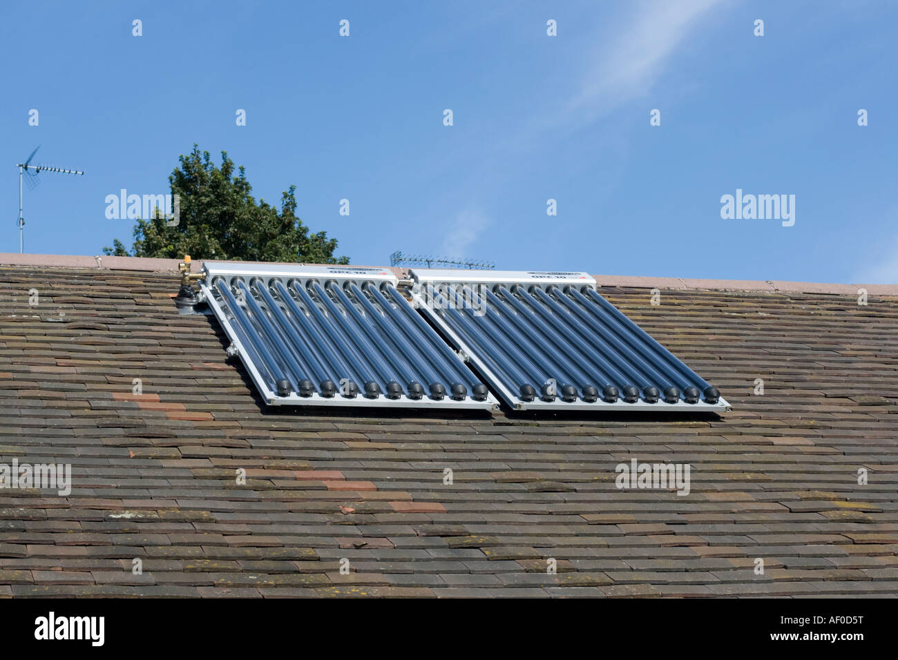 Solar thermal panels with evacuated tubes on roof of Worcestershire House providing domestic hot water UK Stock Photo