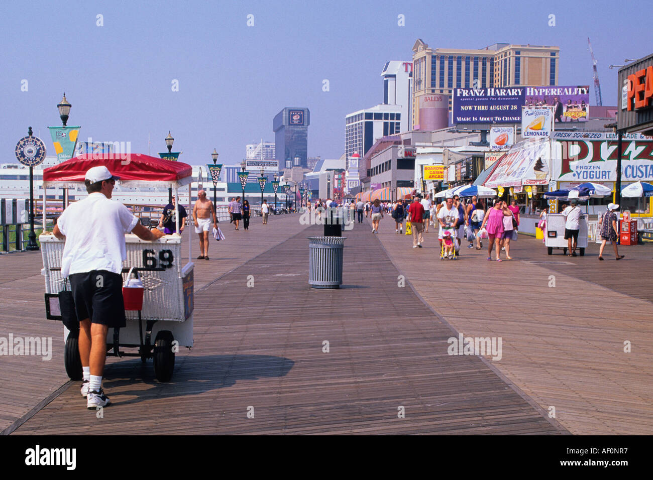 new jersey atlantic city the boardwalk man pushing a rolling chair