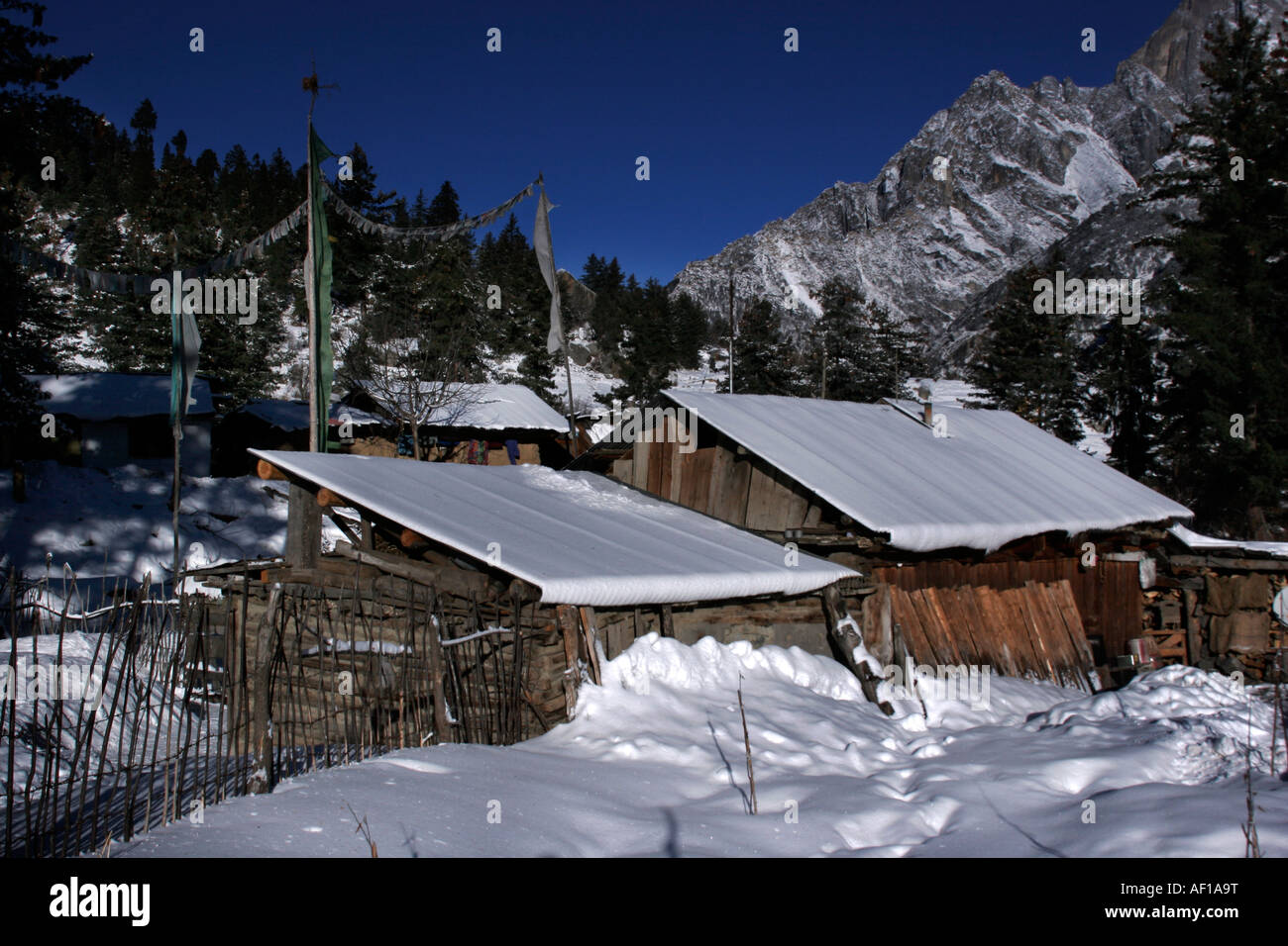 A beautiful landscape of a hut covered under snow during winter season at village Chitkul, Sangla valley Himachal - Stock Image