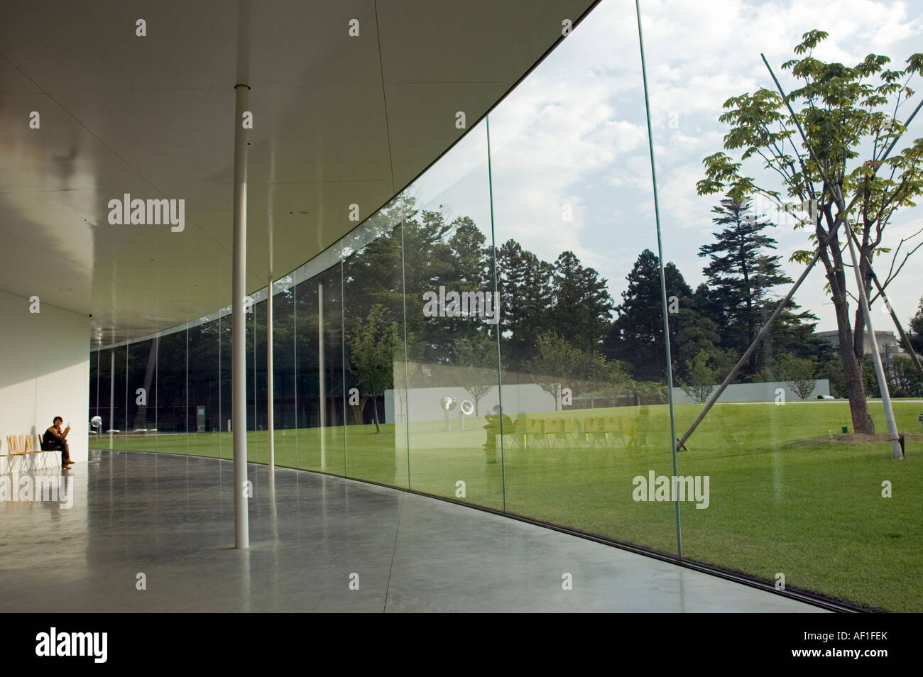 Woman waiting in the foyer of the 21st Century Museum of Contemporary Art, Kanazawa, Japan - Stock Image
