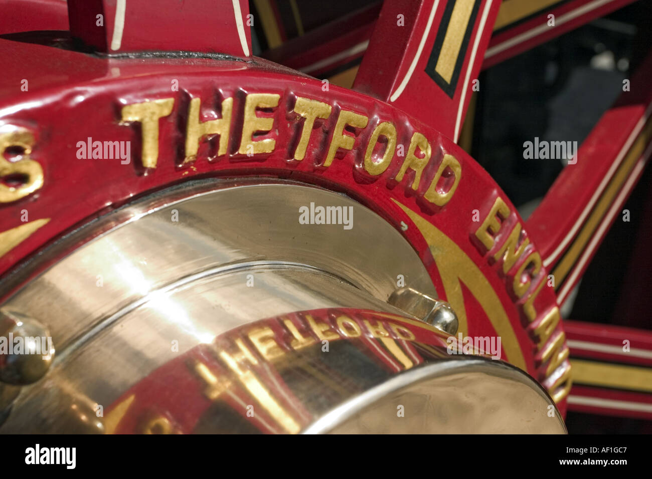 Close up of polished brass wheel bearing on vintage steam traction engine circa 1930 showing Thetford England markings - Stock Image