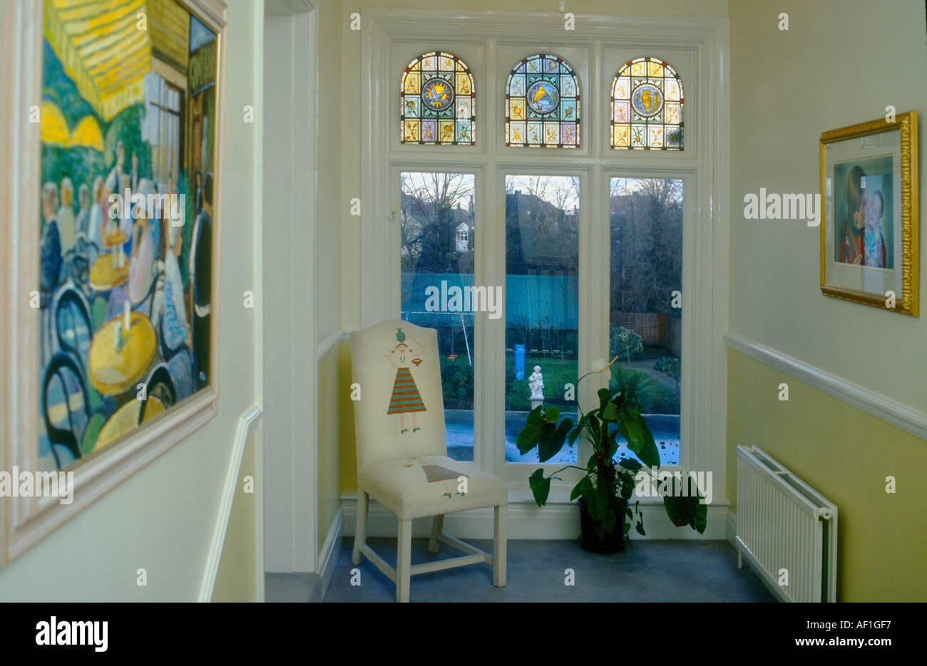 Victorian house interior with three stained glass panels British Housing West London - Stock Image