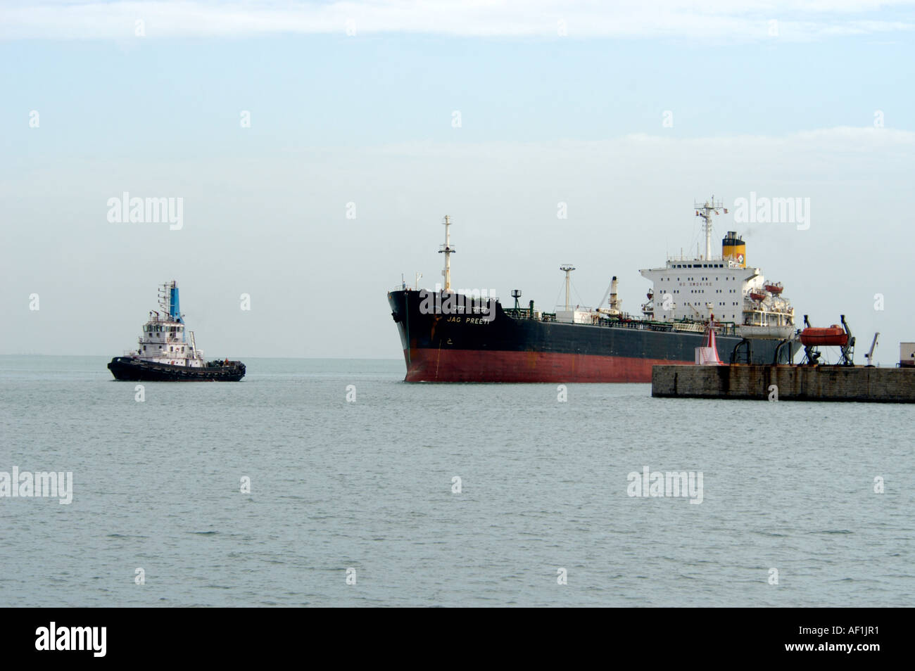 PILOT TUG BOAT LEADING CARGO VESSEL INTO CHENNAI PORT TAMIL