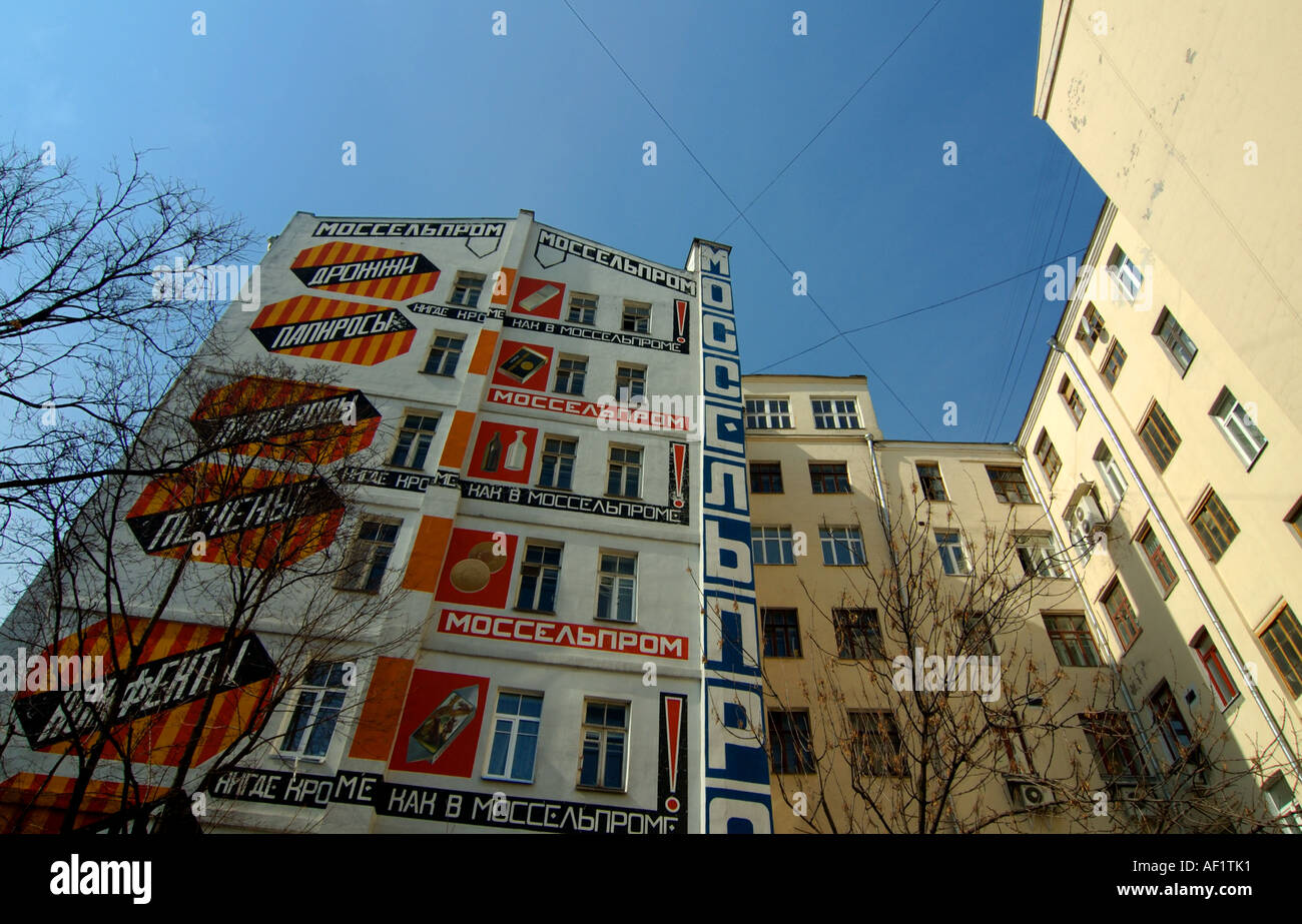 Building with 1920s Soviet advertising restored Moscow - Stock Image