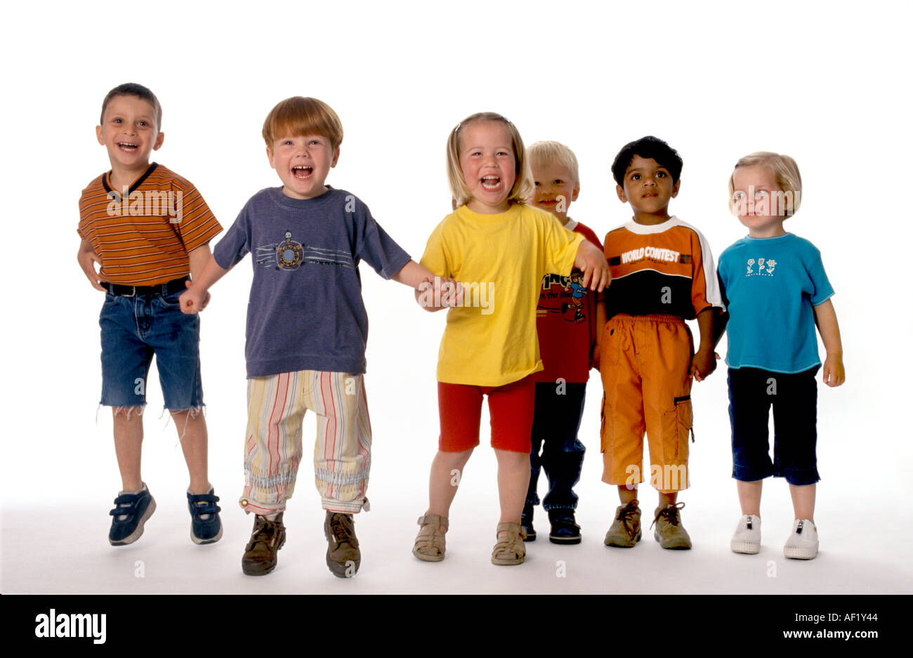 Group of six children in a row in the studio - Stock Image