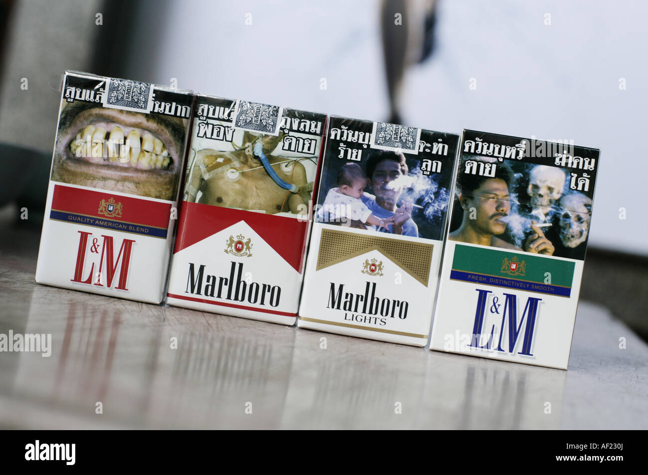 packages of  cigarettes with pictures of dead people, ill, cancer Stock Photo