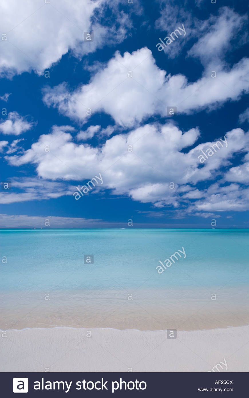A classic view of turquoise seas and white sand at Jolly Beach, Antigua, Caribbean - Stock Image