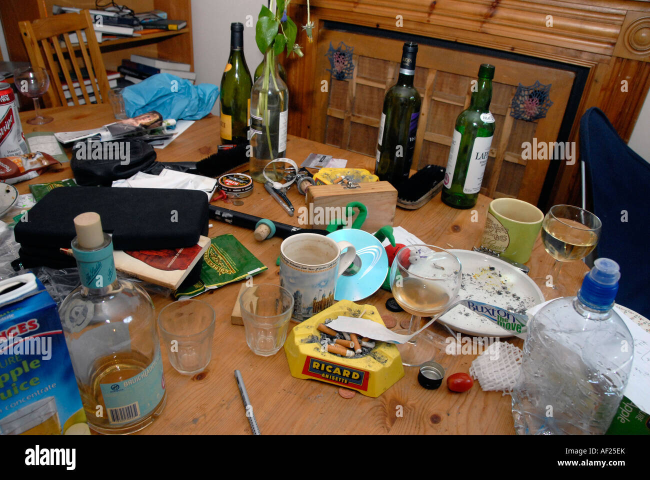 Dining table the morning after a party in Student house. - Stock Image