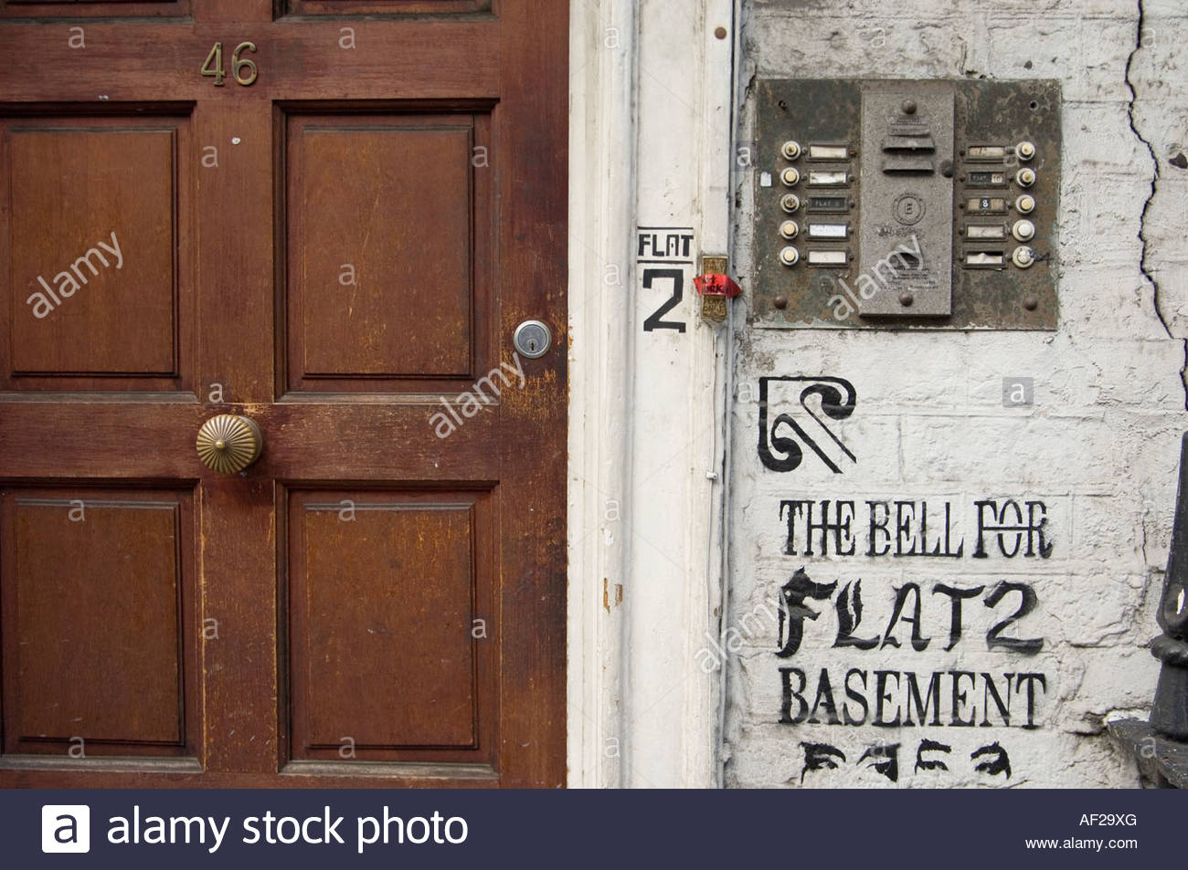 Doorbells on a decaying house in multiple occupation in Fitzrovia central London - Stock Image
