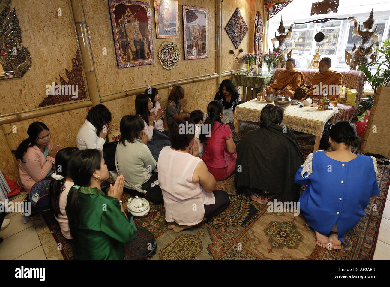 buddhistical blessing ritual in a restaurant, Germany - Stock Image