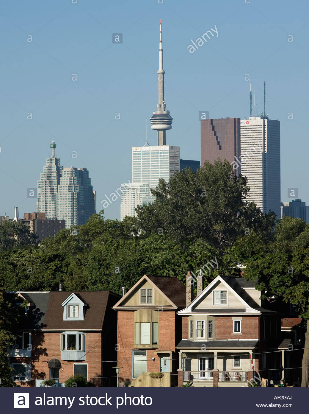 Computer imaging moved these Toronto houses by 100 metres to bring them in line with the skyline of Toronto Ontario - Stock Image