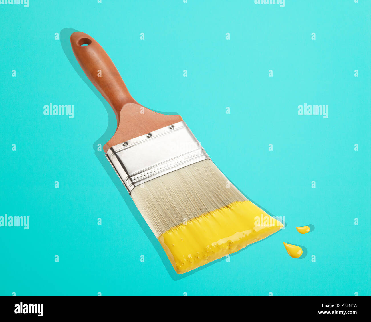 Red Rocket Stock Paint and paintbrush on color background with clipping path - Stock Image