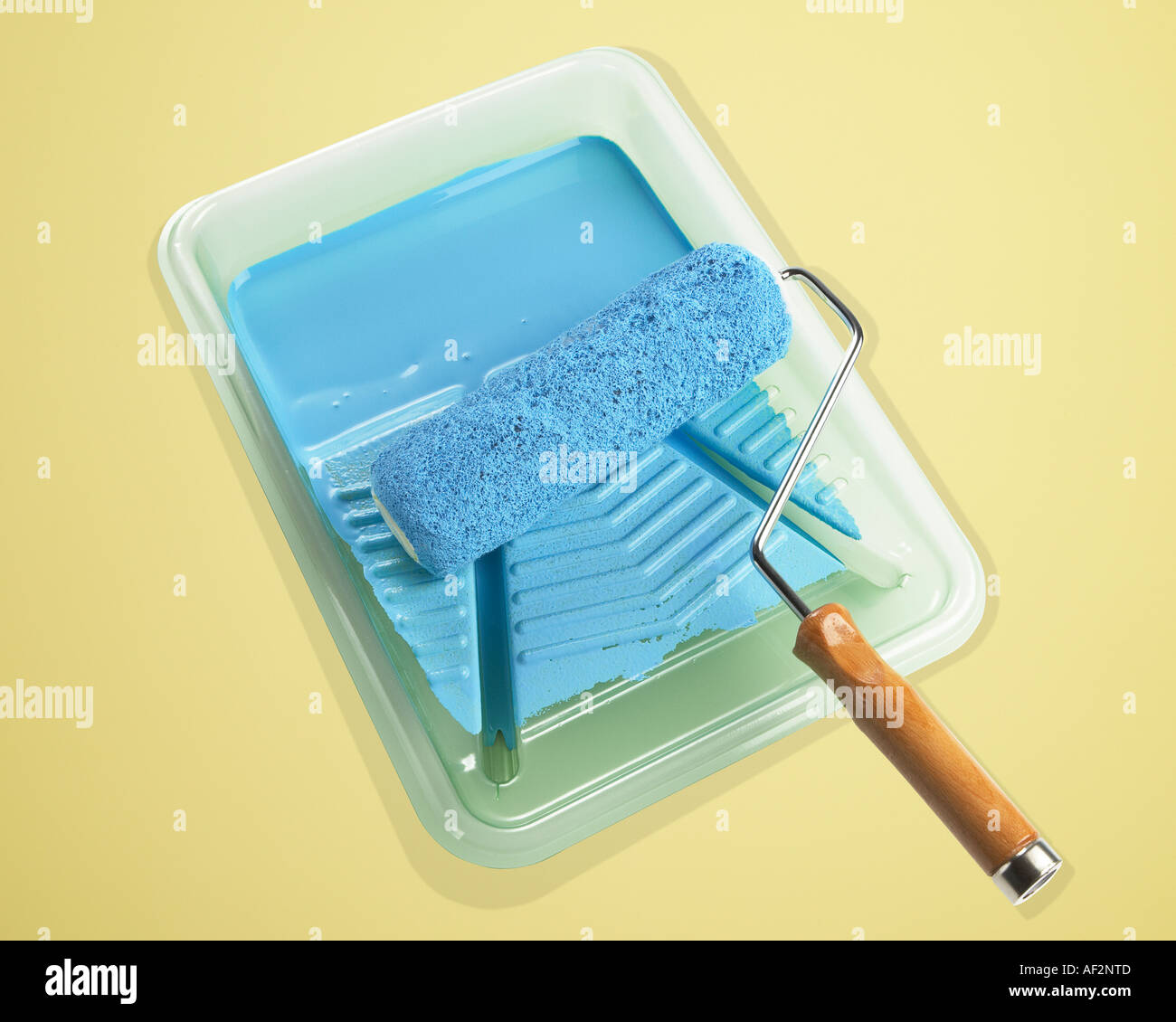 Red Rocket Stock Paint with roller in tray on color background with clipping path - Stock Image