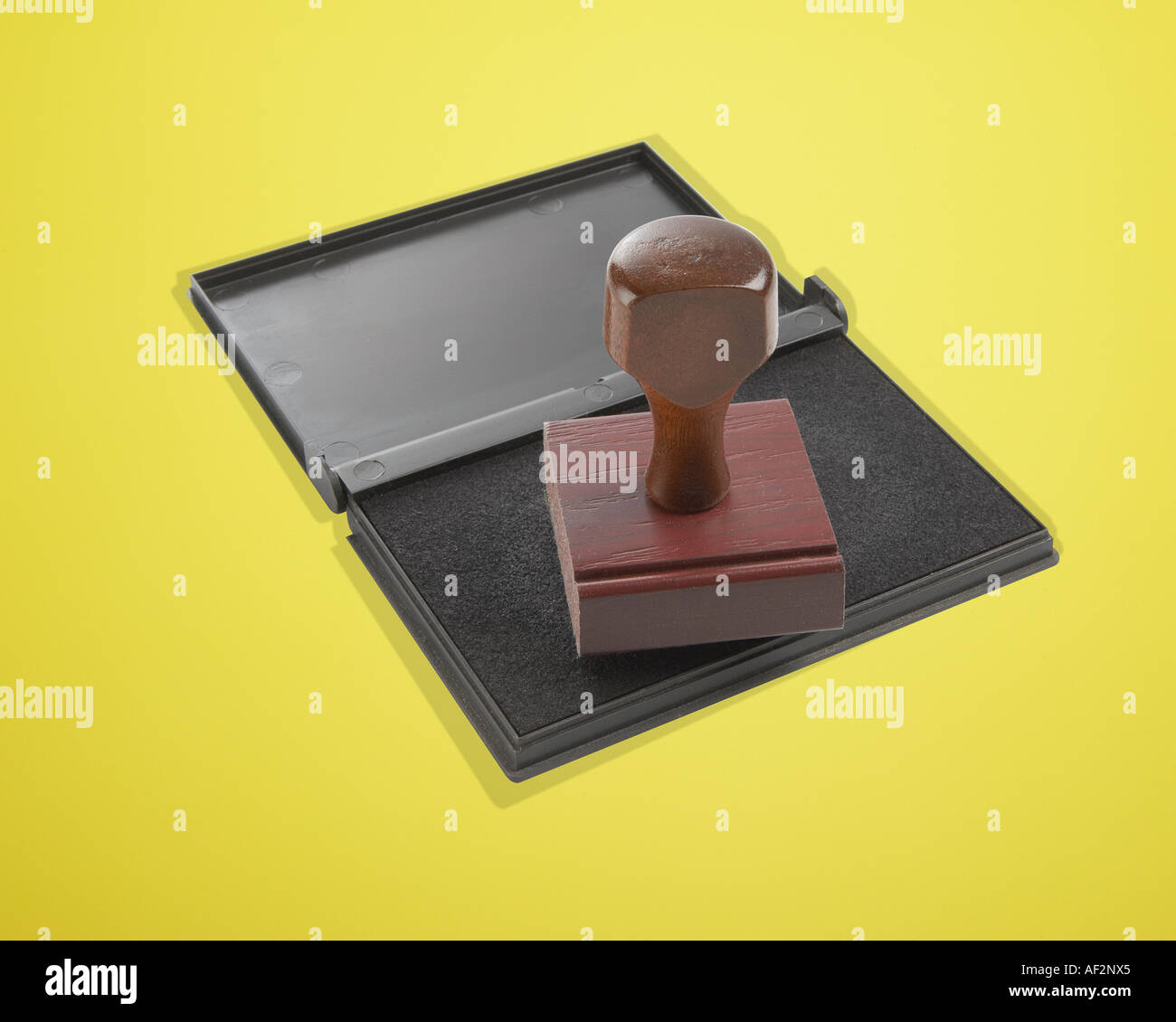 Red Rocket Stock Rubber stamp and pad on color background with clipping path - Stock Image