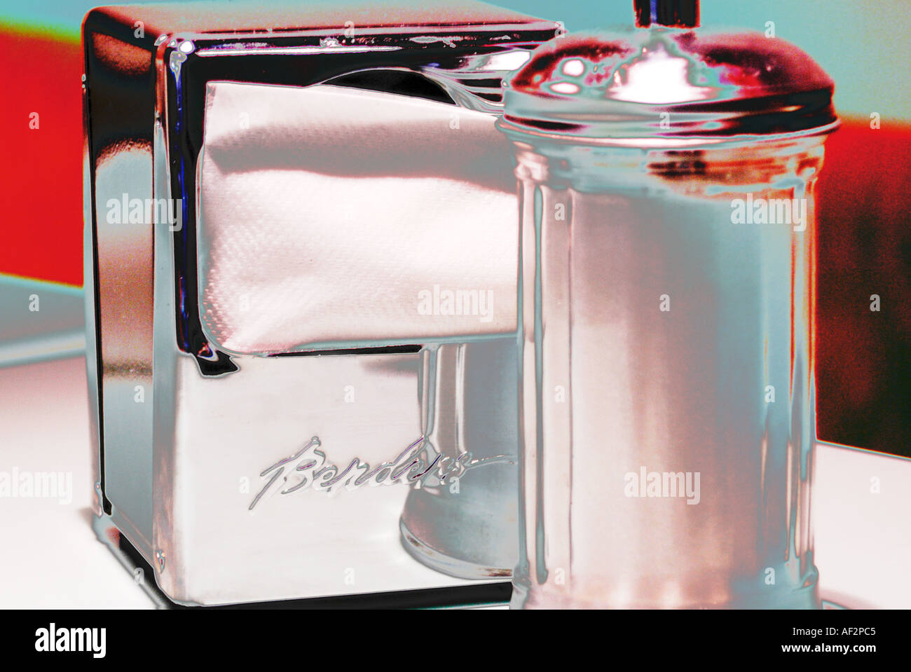 Napkin Holder And Sugar Dispenser On A Restaurant Table Stock Photo Alamy
