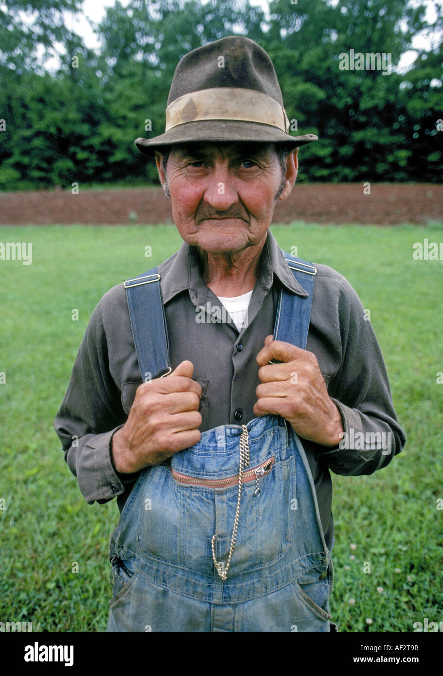 portrait of a hillbilly a farmer dressed in overalls in