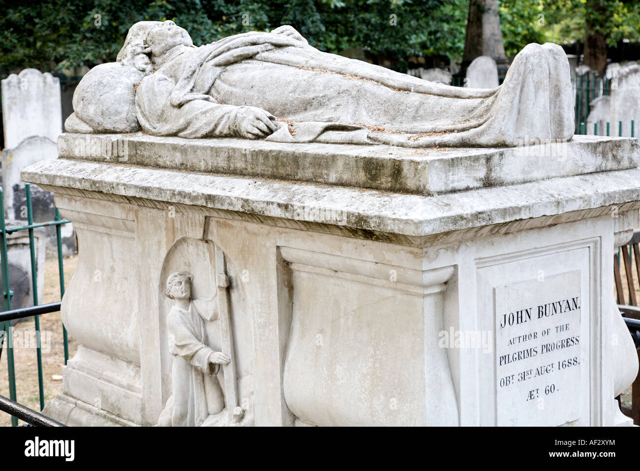 The grave of John Bunyan in Bunhill Fields Cemetery London UK - Stock Image
