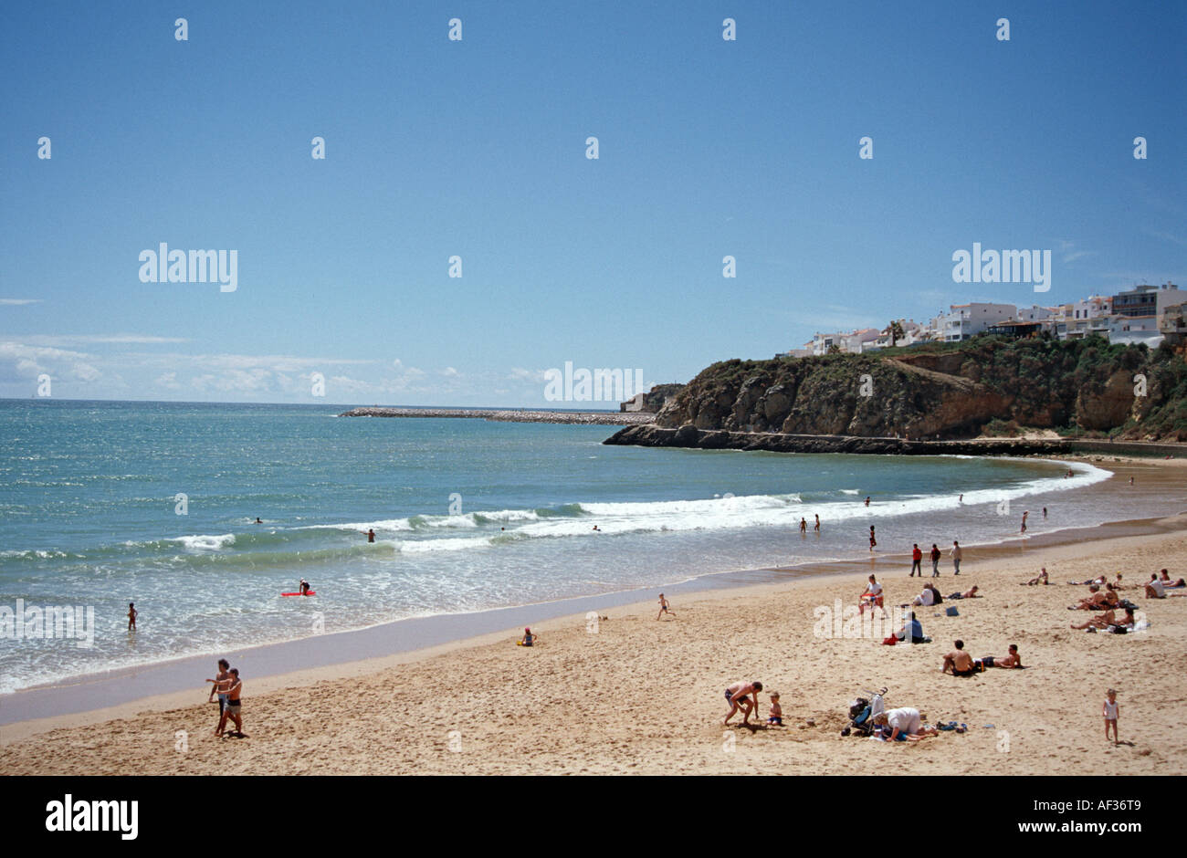 Holidaymakers on the beach at Albufeira Algarve Portugal - Stock Image