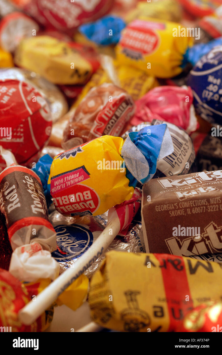 An assortment of individually wrapped single serving candy - Stock Image