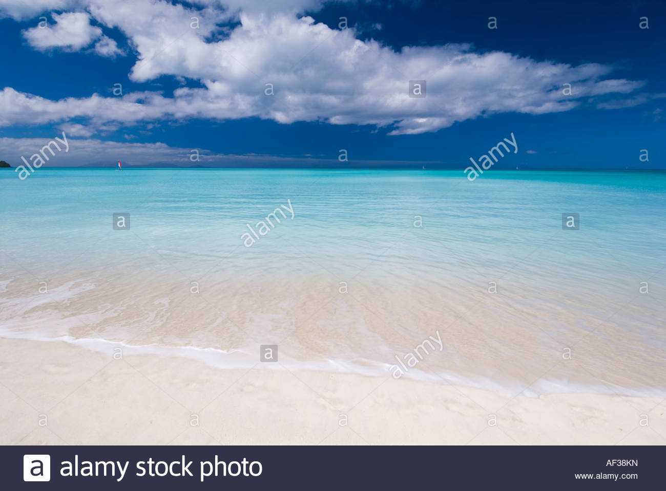 A classic view of turquoise seas and white sand beach at Jolly Beach, Antigua, Caribbean - Stock Image