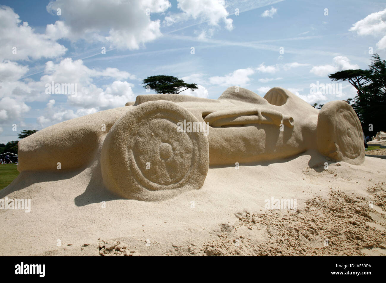 Life size sand sculpture of historic racing car at the Goodwood Festival of Speed, England. - Stock Image