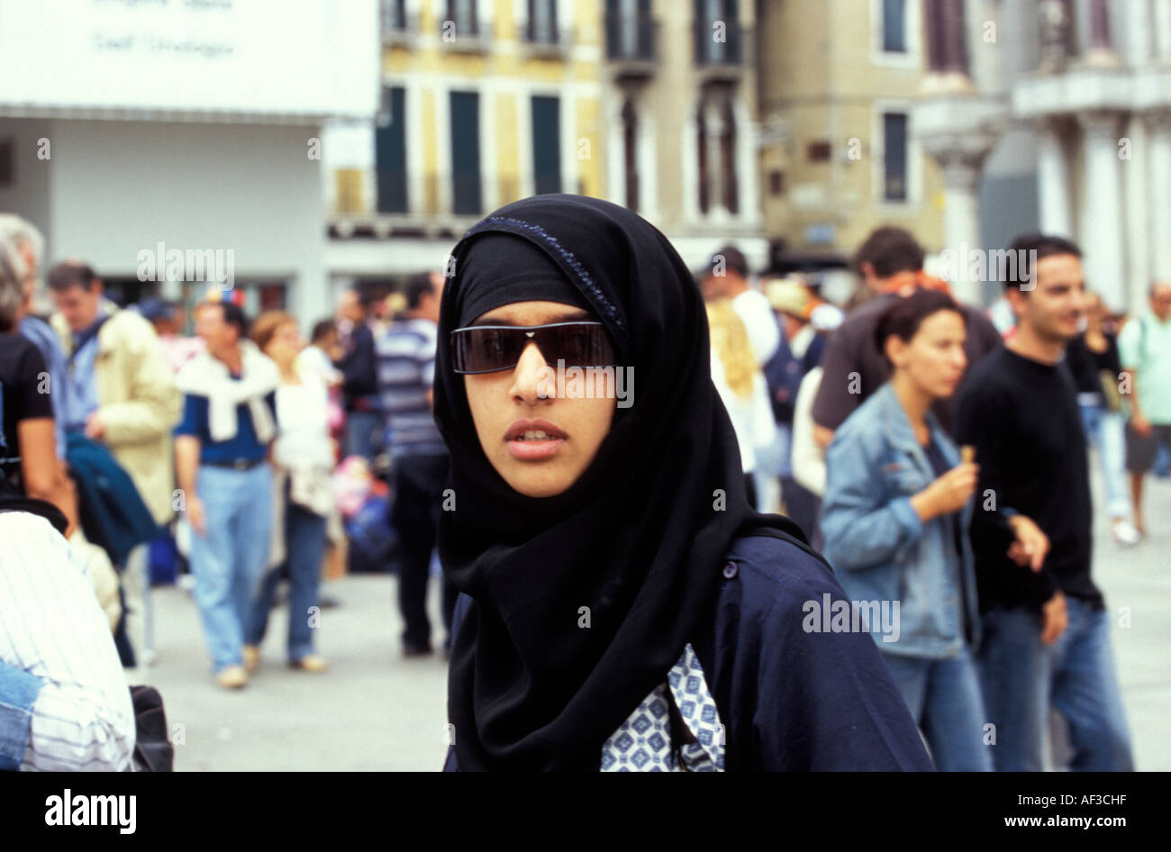 Muslim woman wearing sunglasses and hijab, Piazza San Marco (St. Mark's Square), Venice, Italy - Stock Image