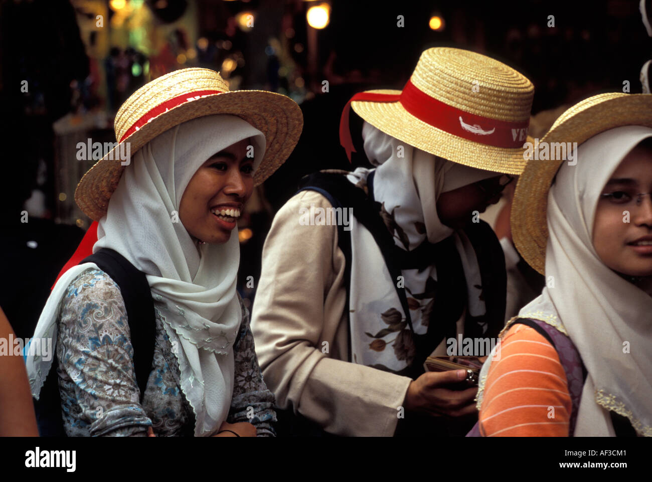 Muslim Women wearing headscarves and boaters, Venice, Italy - Stock Image