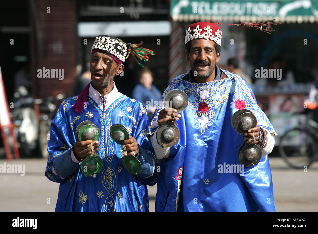 men in traditional dress in Marrakech s main square Stock Photo