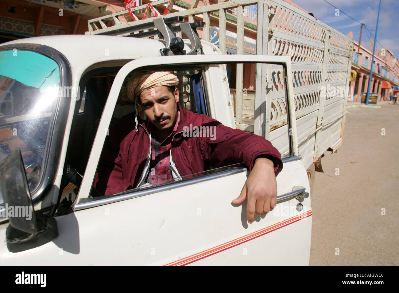 a truck driver in Morrocan occupied western sahara posing for a picture - Stock Image