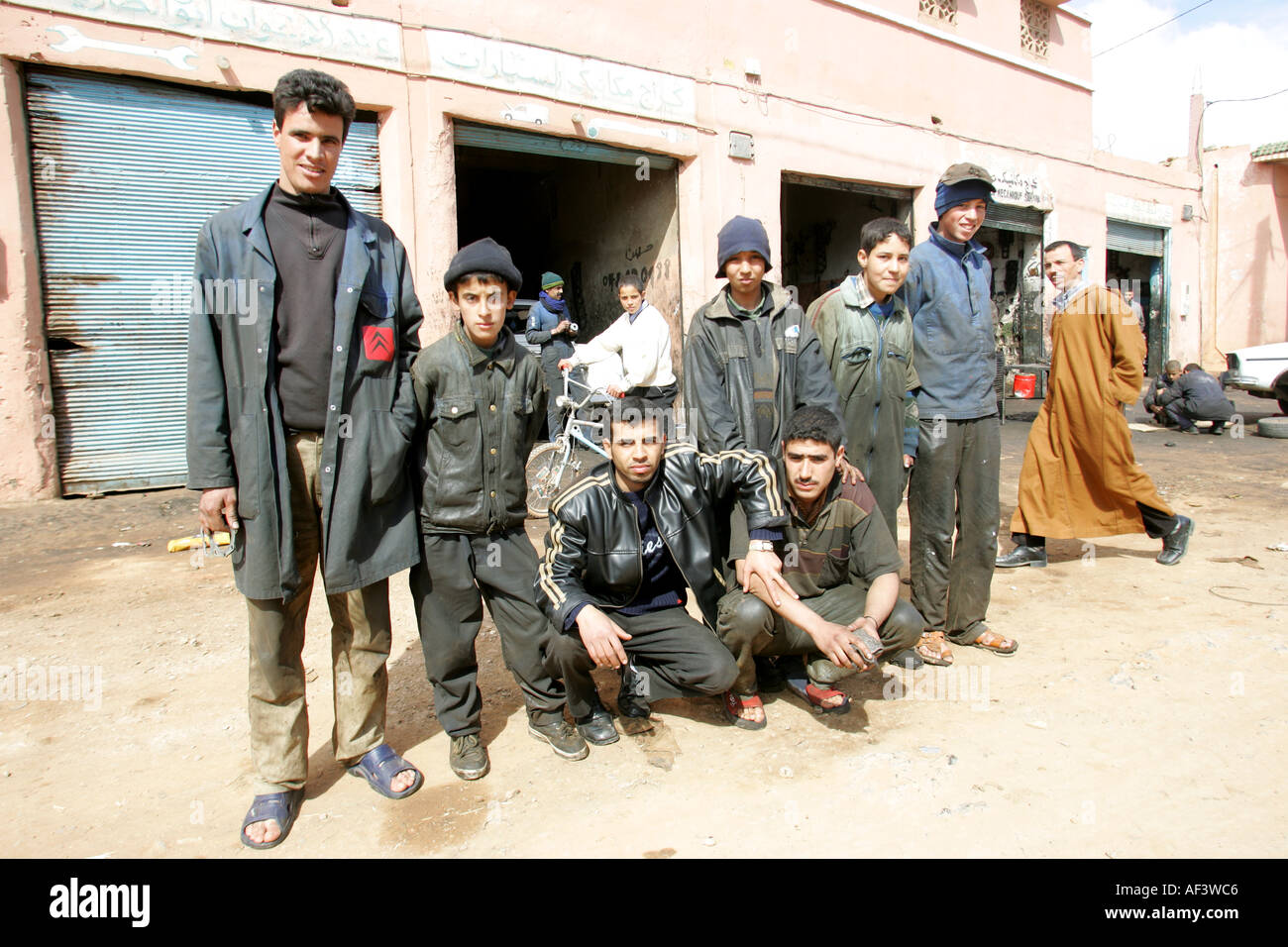 the staff of mechanics of a garage in western sahara occupied by morocco - Stock Image