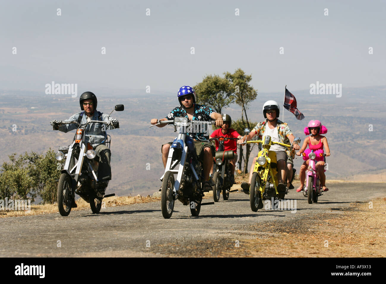 a group of bikers on customised moped motorbikes - Stock Image