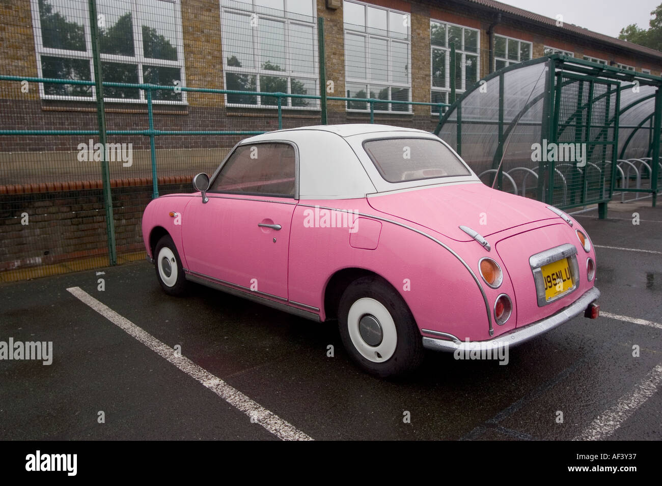Pink and white two tone Nissan Figaro classic cult car Stock Photo
