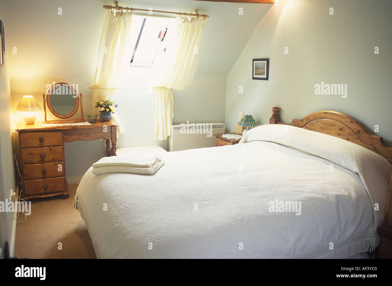 Interior Bedroom holiday cottage with velux window - Stock Image