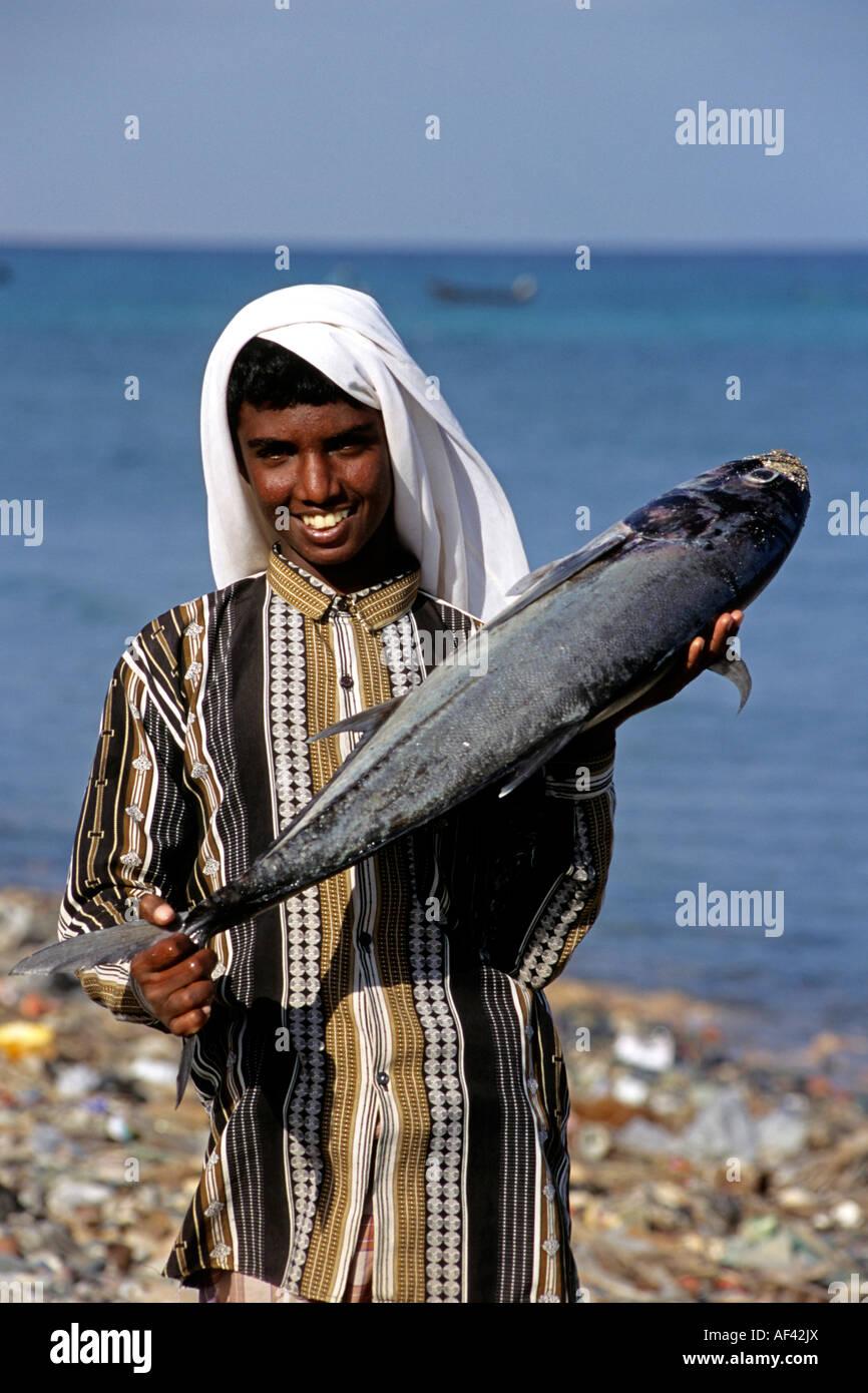 Boy and fish Hadibu sland of Socotra Yemen - Stock Image