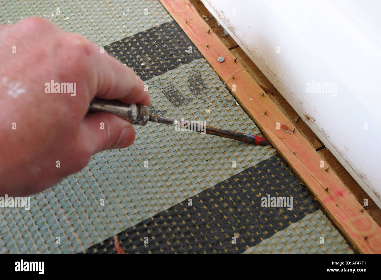 Diy Using A Screwdriver To Lift Up And Remove Carpet