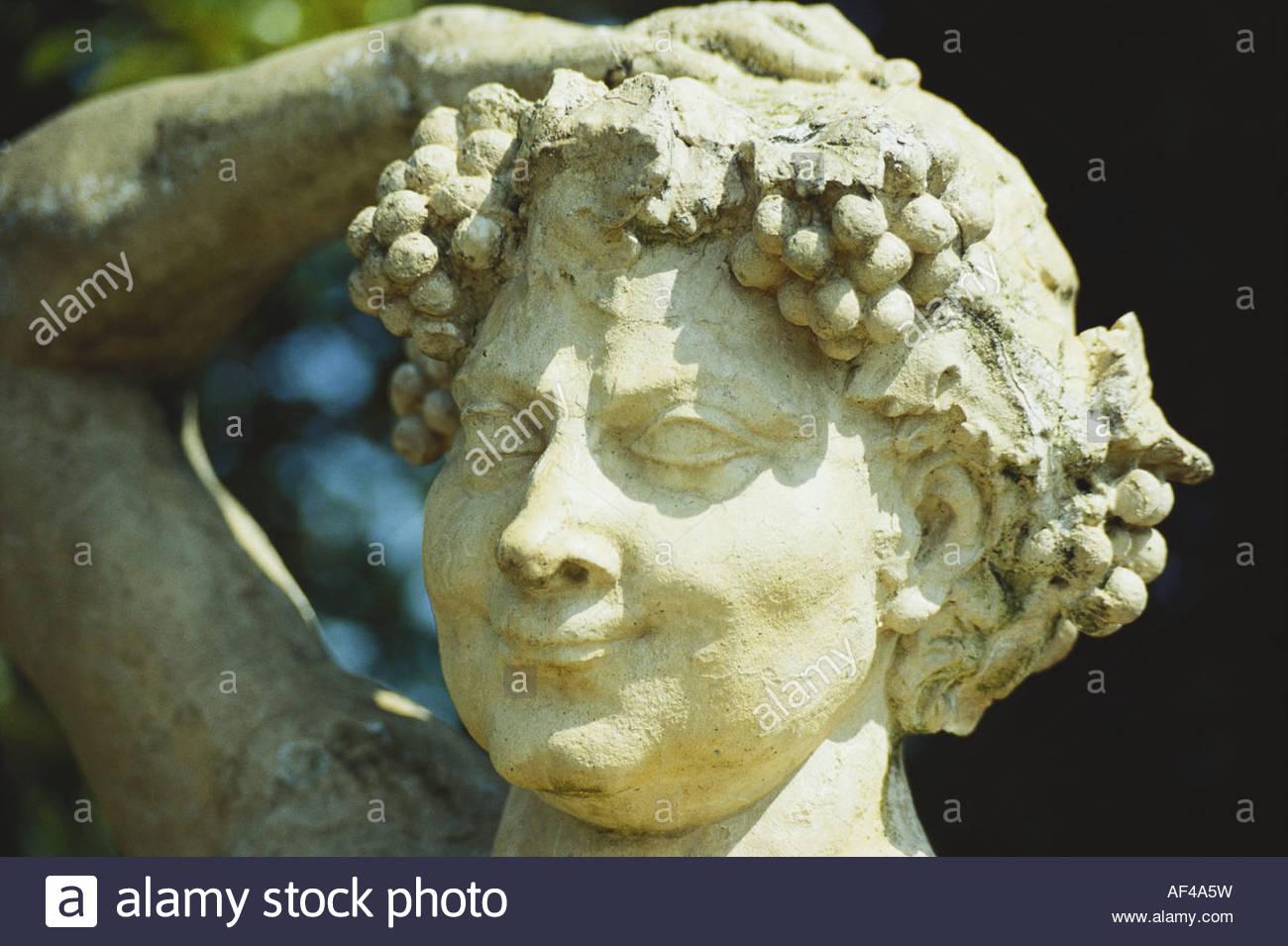 Bacchus (Roman) god of wine, stone figure - Stock Image