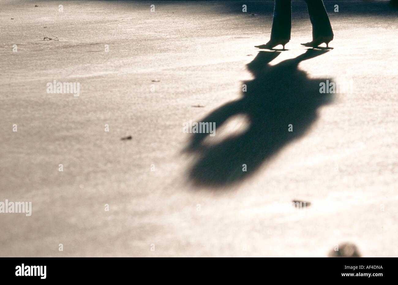 Women legs shadow high-heels high heels - Stock Image