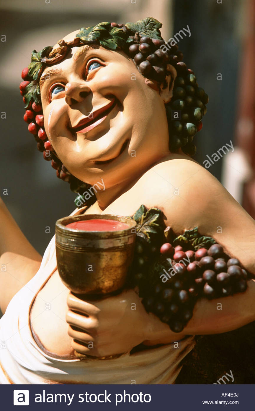 Bacchus, Roman god of wine, painted wooden figure - Stock Image