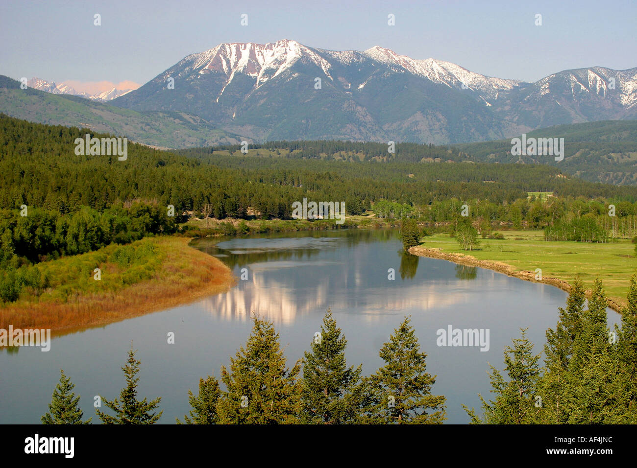 LANDSCAPE ;Snow coverd mountain reflected in a smwll pond - Stock Image