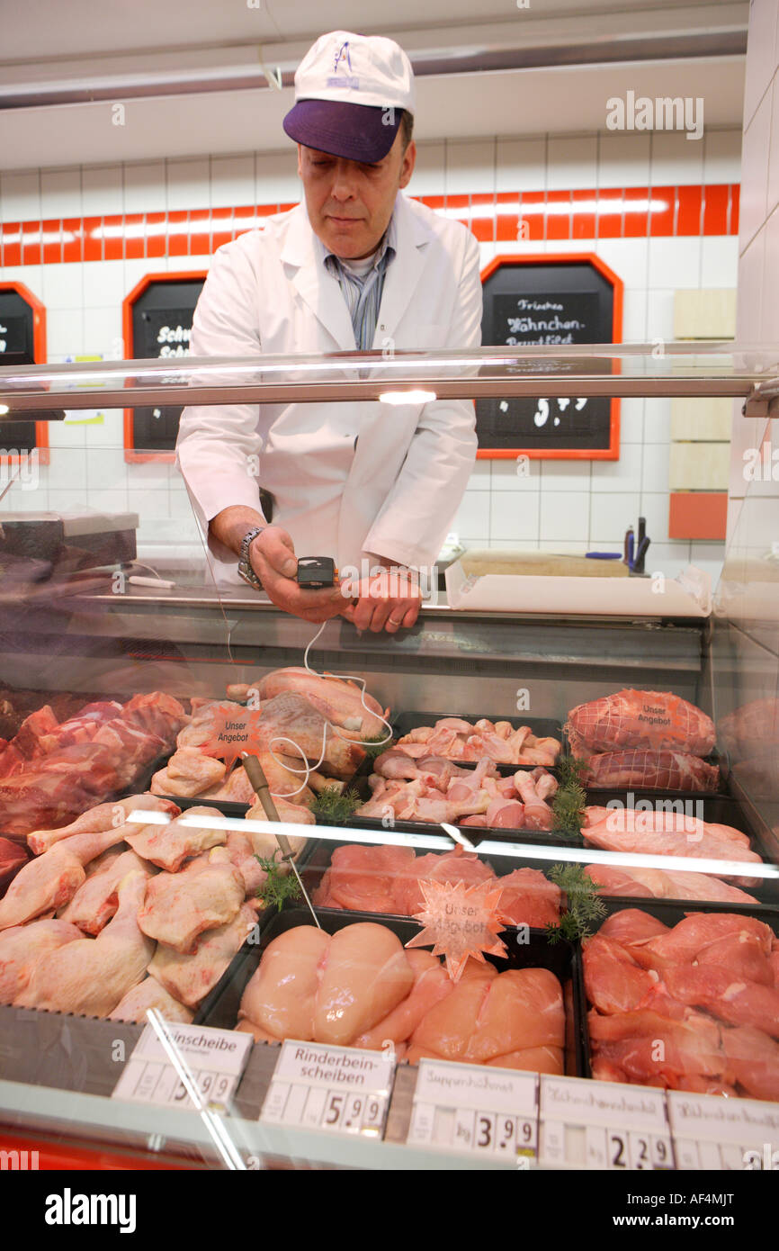Food quality control Inspector during the temperature measurement in a butcher s shop in a supermarket - Stock Image