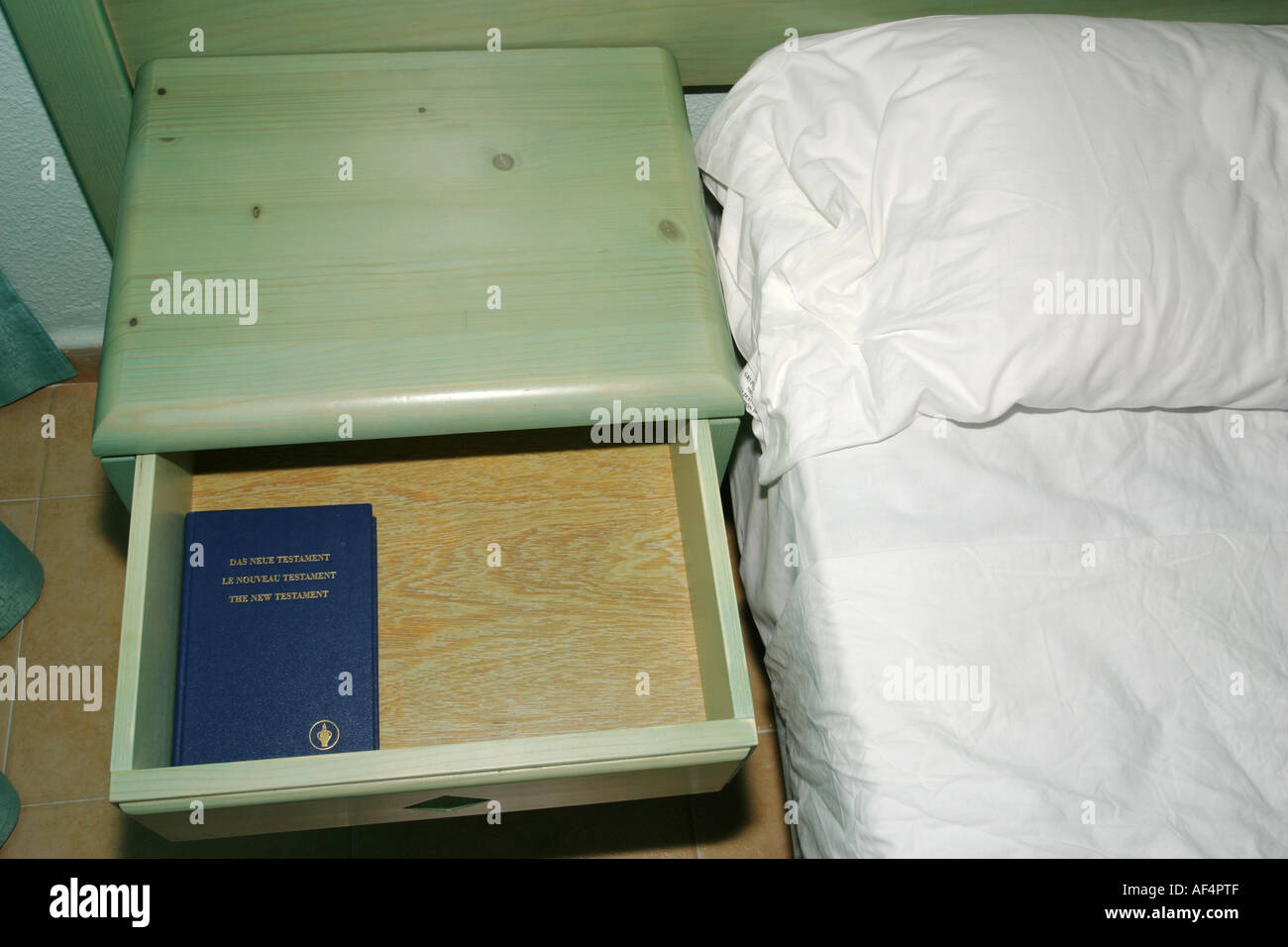 The New Testament in a hotel drawer put there by the Gideons - Stock Image