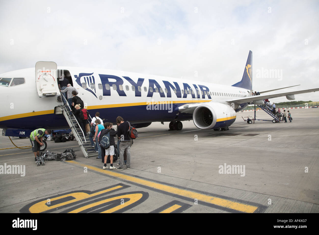 Ryanair plane with passengers boarding - Stock Image