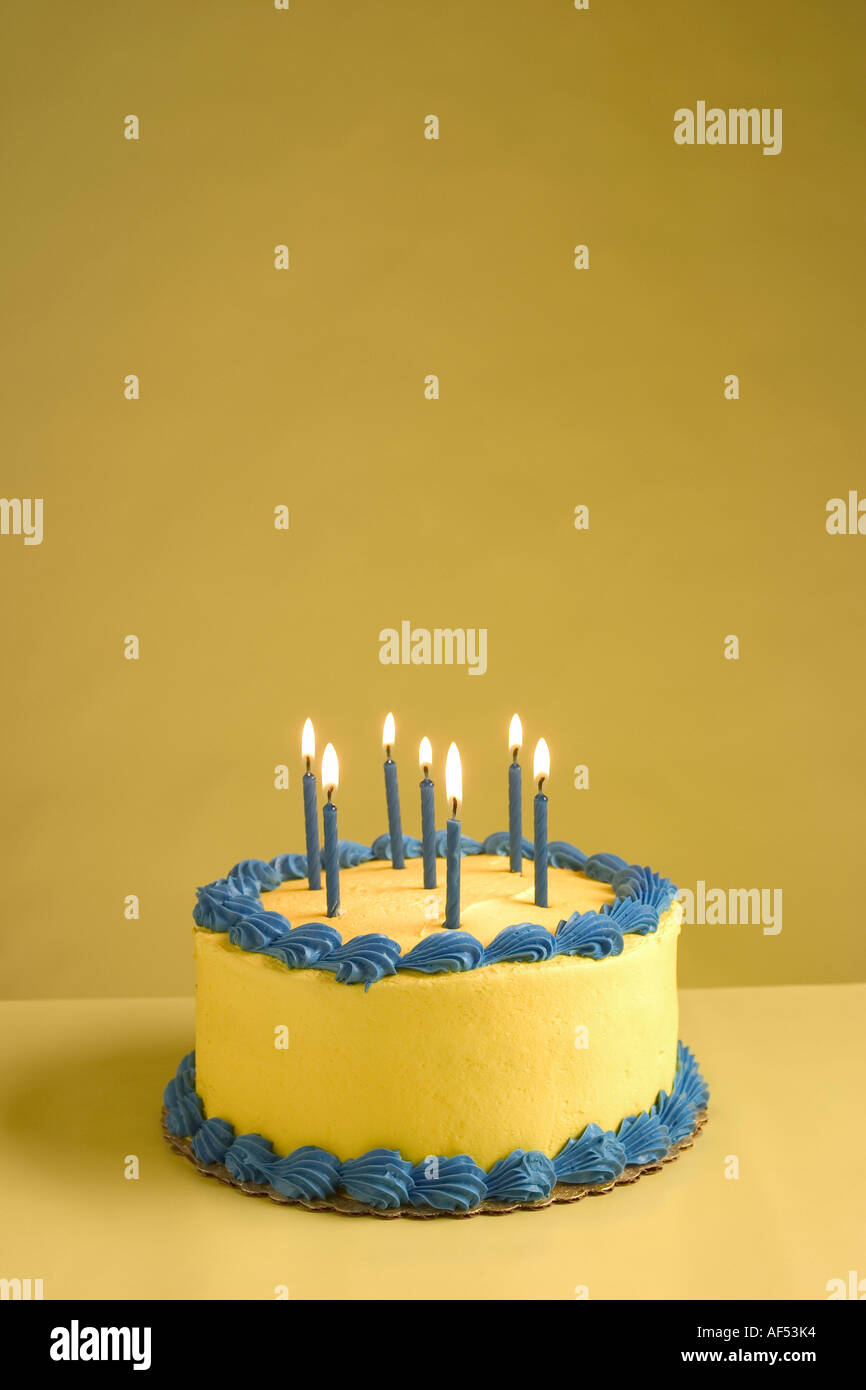 Close Up Of Lit Candles On A Birthday Cake