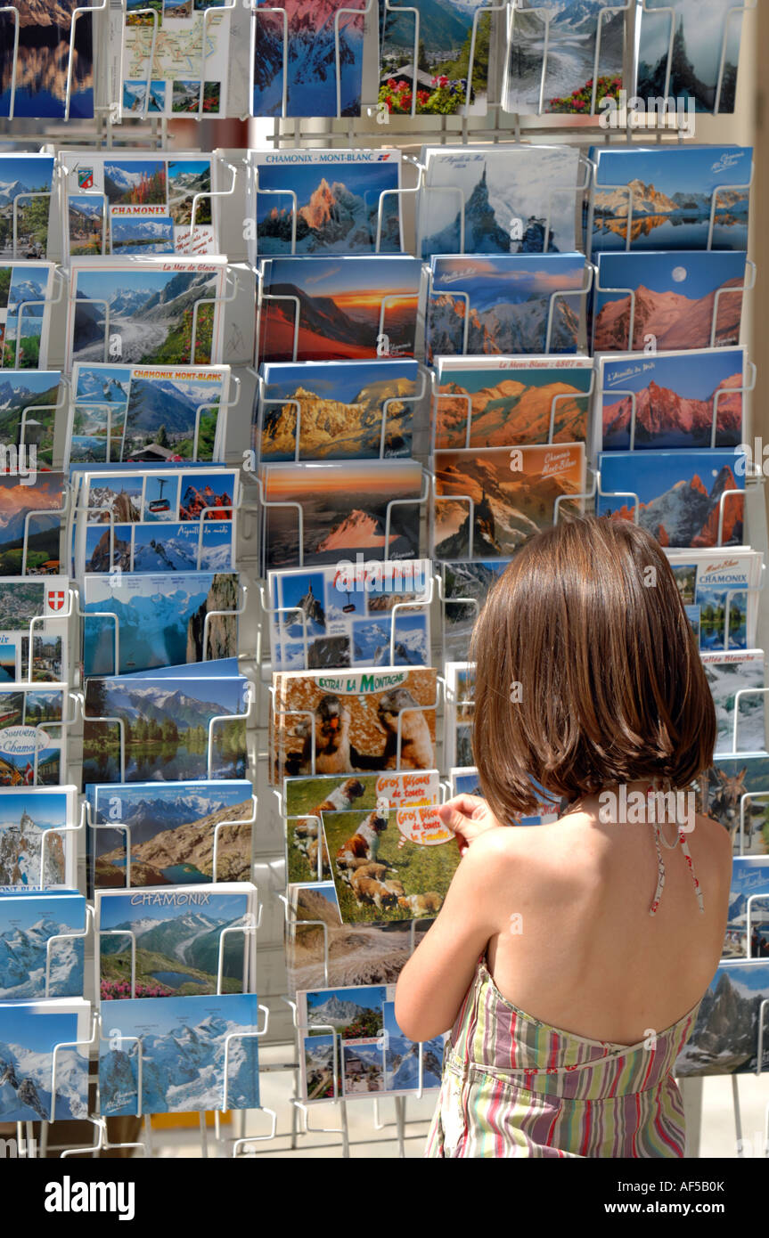 Girl chooses a postcard in Chamonix, France - Stock Image