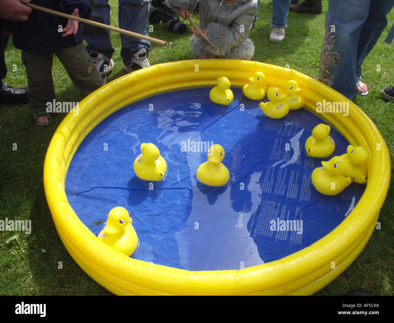 Hook The Duck Game At Summer Fete Suffolk England Stock