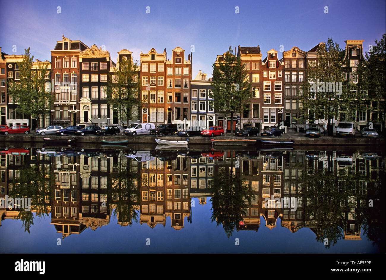 Netherlands Amsterdam Reflection of building in canal called Singel - Stock Image