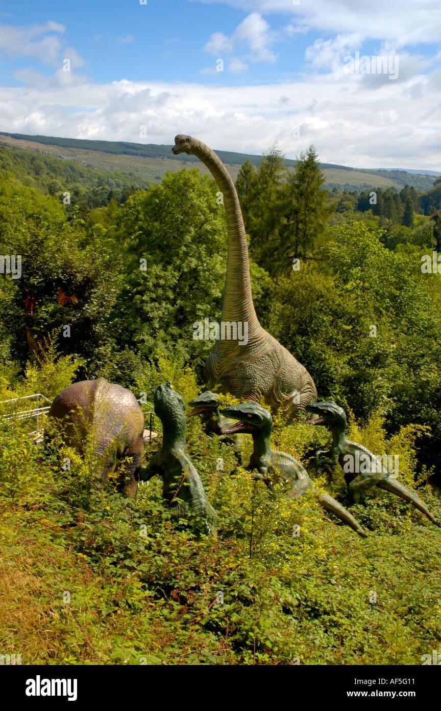 Prehistoric dinosaurs in hunting scene - Stock Image